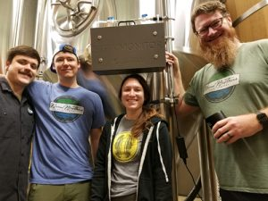 Bond Brothers team with the BrewMonitor X-1 device on one of their fermemtation tanks.